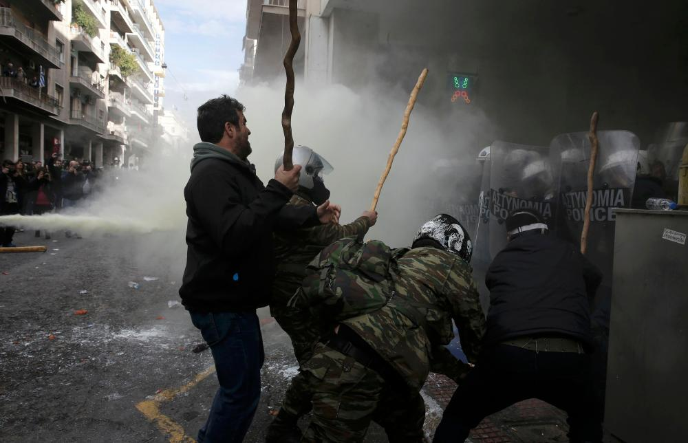 Greek farmers from the region of Crete clash with police during a protest against planned pension reforms outside the Agriculture ministry in Athens, Greece, February 12, 2016. REUTERS/Alkis Konstantinidis