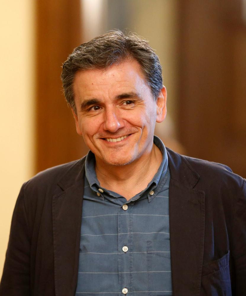 "Swearing in of new Greek Finance Minister Euclid Tsakalotos<br />epa04834287 New Greek Finance Minister Euclides Tsakalotos during his swearing-in ceremony at the Presidential Palace in Athens, Greece, 06 July 2015. Greek voters resoundingly rejected bailout terms in a referendum on 05 July. Athens said it was willing to resume talks with international creditors, and eurozone leaders were planning an emergency summit on 07 July to tackle the crisis. EPA/ARMANDO BABANI"" width=""831″ height=""1000″ class=""gu-image"" /> </figure> <figure class="