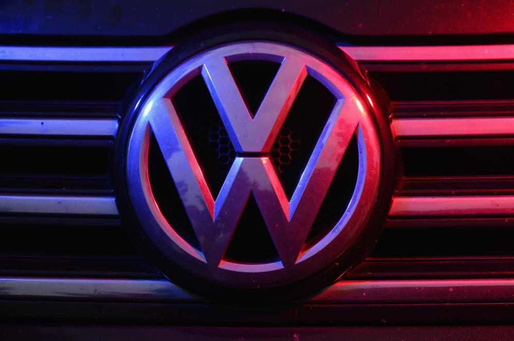 Volkswagen Wrestles With Diesel Emissions Scandal<br />BERLIN, GERMANY - OCTOBER 06: The Volkswagen logo is visible under coloured lights on the front of a Volkswagen Passat 2.0 turbodiesel passenger car affected by the Volkswagen diesel emissions software scandal on October 6, 2015 in Berlin, Germany.