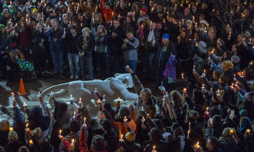 Mourners attend a vigil held on the University of Colorado-Colorado Springs' campus for those killed in Friday's shooting at a Planned Parenthood clinic.