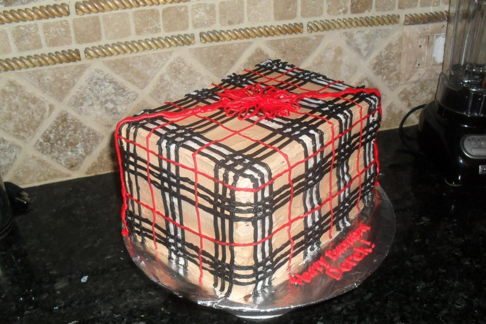 A cake iced in imitation Burberry print