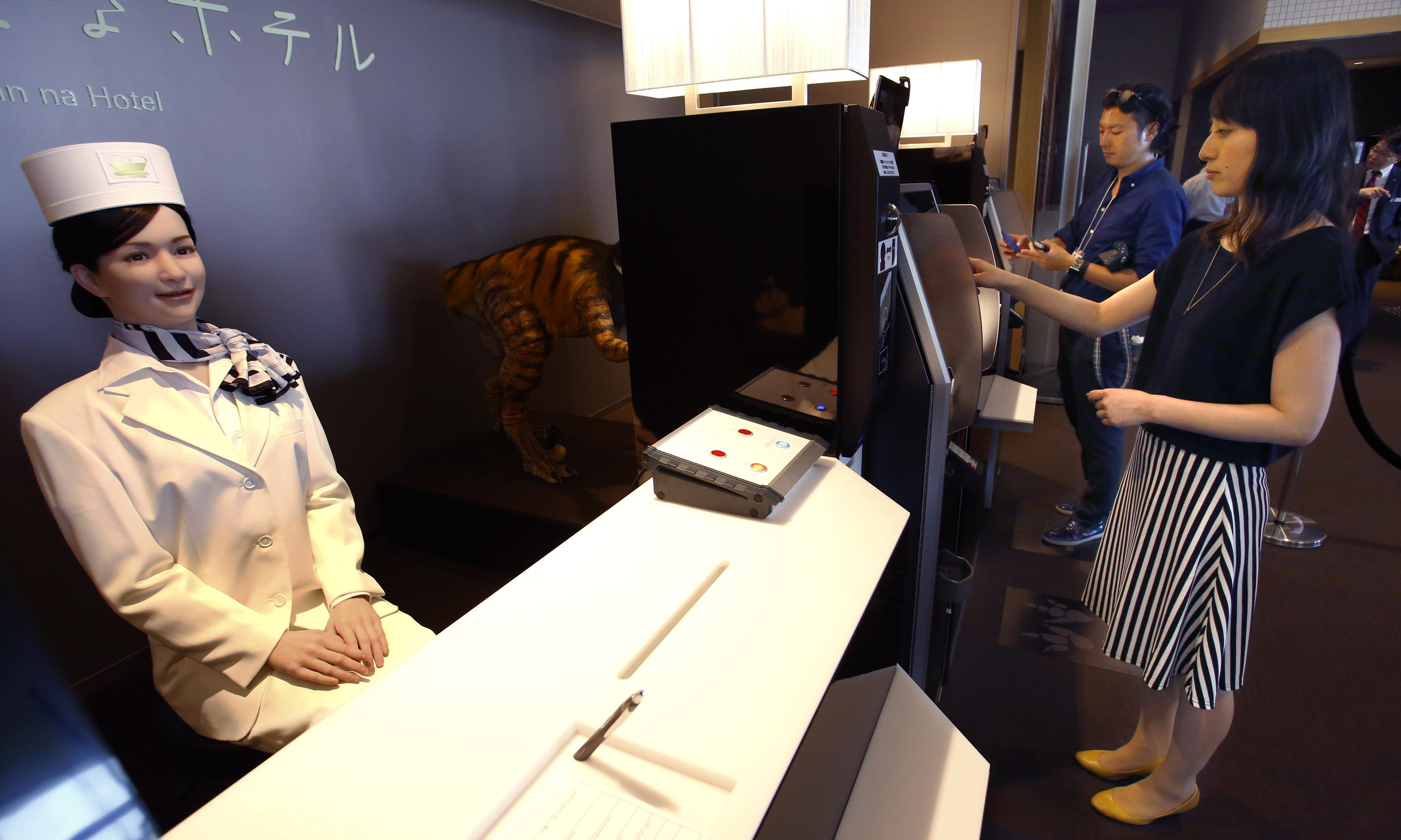 Japan's robot hotel: a dinosaur at reception, a machine for room service