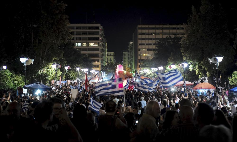 """No"" supporte""No"" supporters wave Greek national flags during celebrations in Athens, Greece<br />""No"" supporters wave Greek national flags during celebrations in Athens, Greece July 5, 2015. Greeks overwhelmingly rejected conditions of a rescue package from creditors on Sunday, throwing the future of the country's euro zone membership into further doubt and deepening a standoff with lenders. REUTERS/Dimitris Michalakis"" width=""1000″ height=""600″ class=""gu-image"" /><br /> <figcaption> <span class="