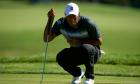 Tiger Woods shoots 66 to stay in contention at Quicken Loans National