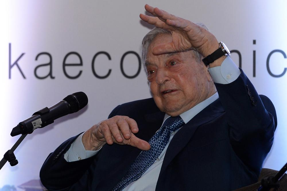Hungarian-born US magnate and philanthropist George Soros attends an economic forum in Colombo on January 7, 2016. Sri Lankas new government is trying to woo investors after a year in office. AFP PHOTO / LAKRUWAN WANNIARACHCHILAKRUWAN WANNIARACHCHI/AFP/Getty Images