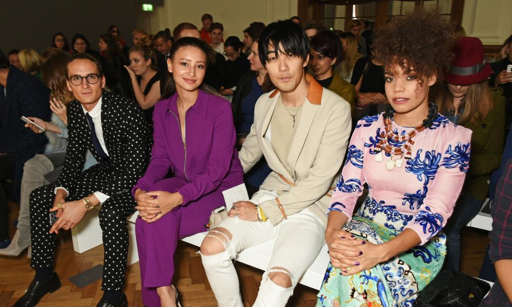 Actor and singer Leah Weller, second left, joins the fashion pack on the front row of the Daks show.