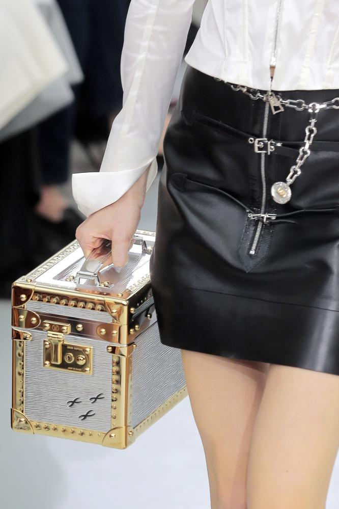 A model holds one of the latest Louis Vutton designs, described by Nicolas Ghesquière as 'a digital toolbox for today'.