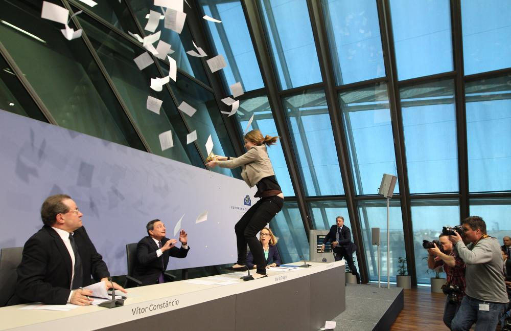 A woman disrupts a press conference by Mario Draghi, President of the European Central Bank, (ECB) following a meeting of the Governing Council ain Frankfurt / Main, Germany, on April 15, 2015. AFP PHOTO / DANIEL ROLANDDANIEL ROLAND/AFP/Getty Images