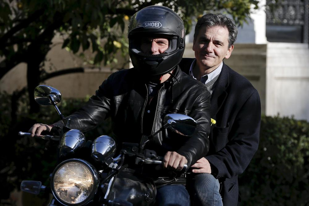 File photo of Varoufakis and Tsakalotos leaving the Maximos Mansion after a meeting with PM Tsipras in Athens<br />Greek Finance Minister Yanis Varoufakis (front) and deputy minister for international economic relations Euclid Tsakalotos leave the Maximos Mansion after a meeting with Prime Minister Alexis Tsipras (not pictured) in Athens in this April 3, 2015 file photo. Tsakalotos will be sworn in as finance minister on July 6, 2015 after the resignation of Varoufakis, a Greek presidency source said. REUTERS/Alkis Konstantinidis/Files&#8221; width=&#8221;1000&#8243; height=&#8221;667&#8243; class=&#8221;gu-image&#8221; /><br /> <figcaption> <span class=