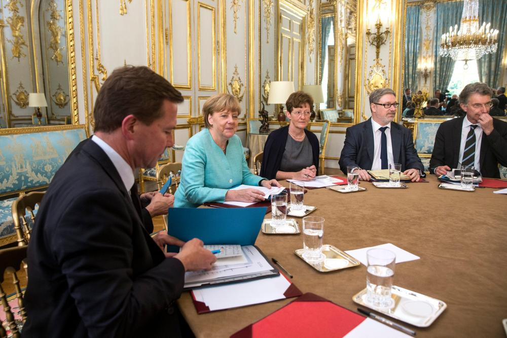 Crisis meeting in Paris between French President and German Chancellor<br />epa04834201 German Chancellor Angela Merkel (2-L) attends a crisis meeting with French President Francois Hollande (unseen) at the Elysee Palace regarding Greece, in Paris, France, 06 July 2015. The leaders met for talks on Greece in the aftermath of the referendum. EPA/ETIENNE LAURENT / POOL MAXPPP OUT&#8221; width=&#8221;1000&#8243; height=&#8221;667&#8243; class=&#8221;gu-image&#8221; /><br /> <figcaption> <span class=