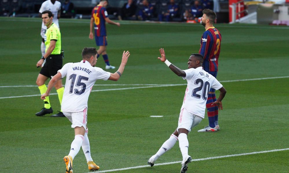 Real Madrid's Federico Valverde celebrates scoring their first goal with Vinicius Junior.