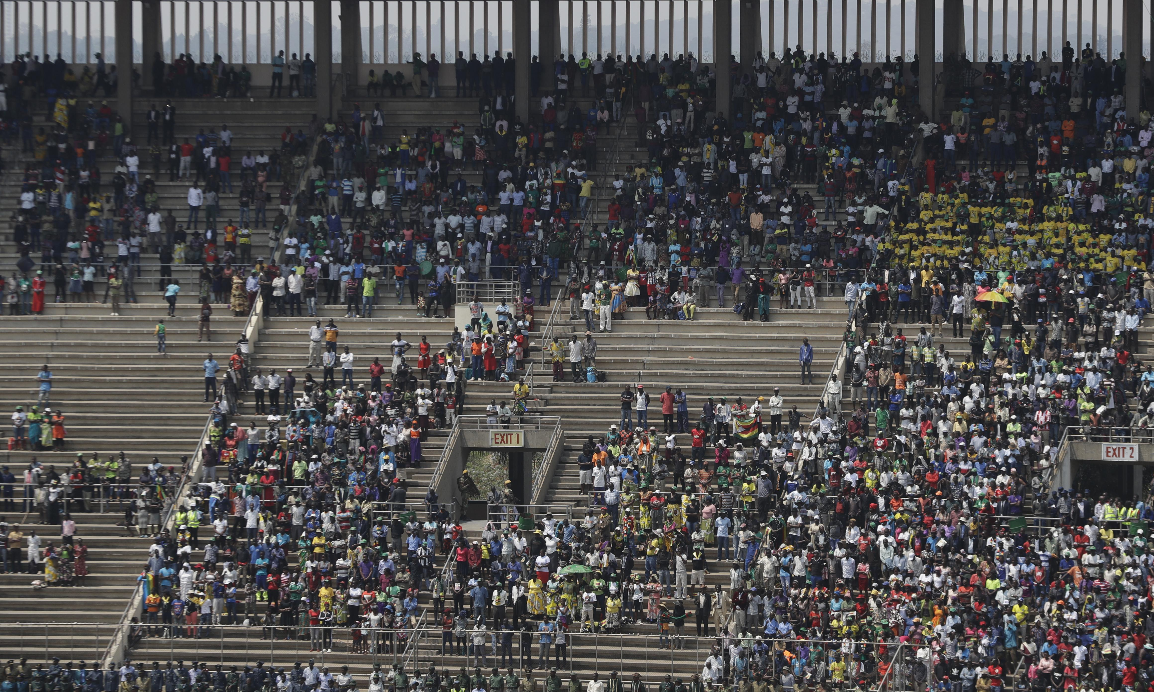 Pomp, thin crowds and mixed feelings as Robert Mugabe is buried