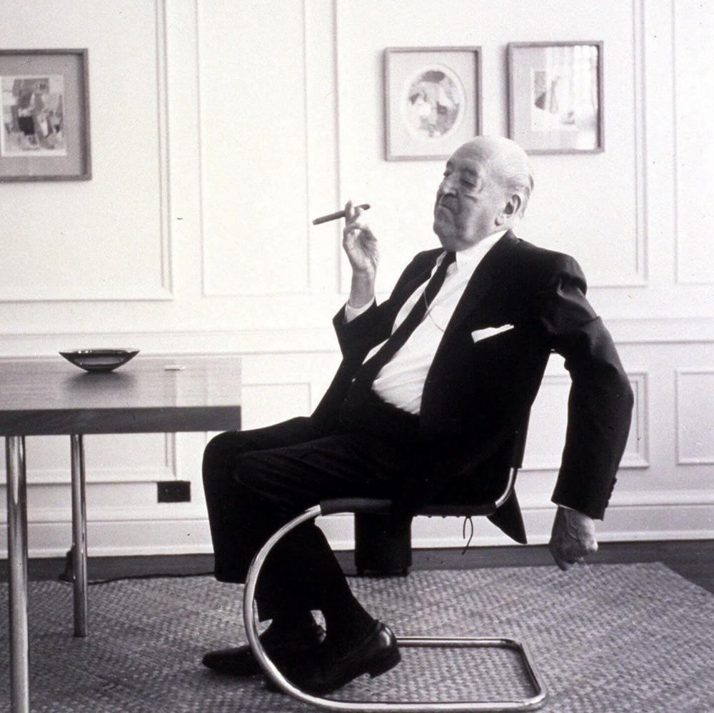 Architect Ludwig Mies van der Rohe smokes a cigar in his Chicago apartment in 1964.