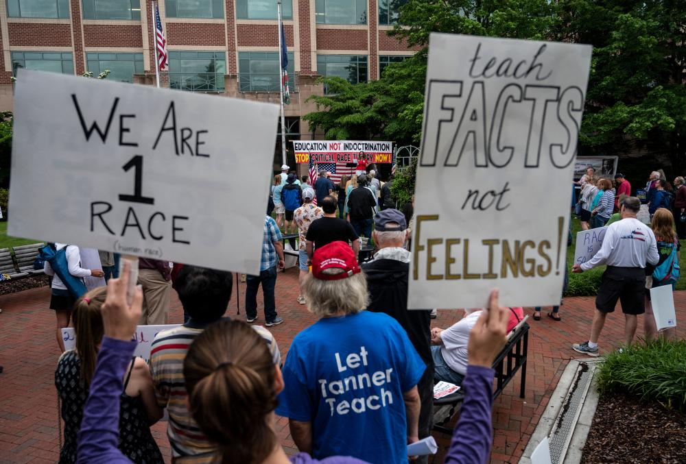 People protesting critical race theory being taught in schools in Leesburg, Virginia, in June.