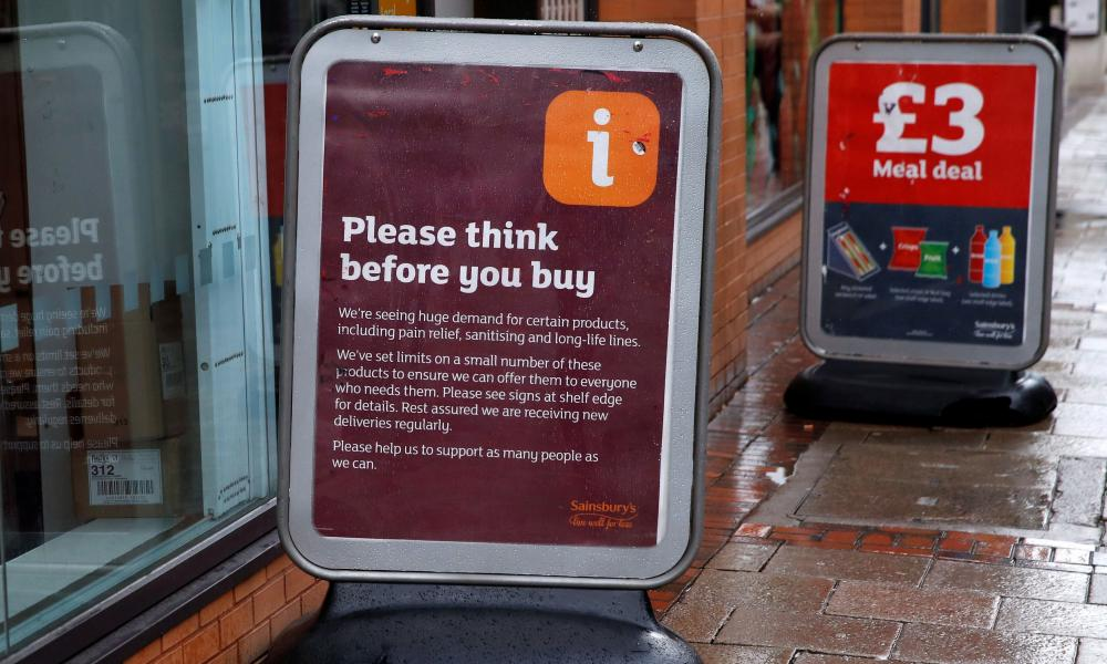 A sign warning customers of product shortages outside a Sainsbury's Local supermarket in central Birmingham, Britain, March 15, 2020.