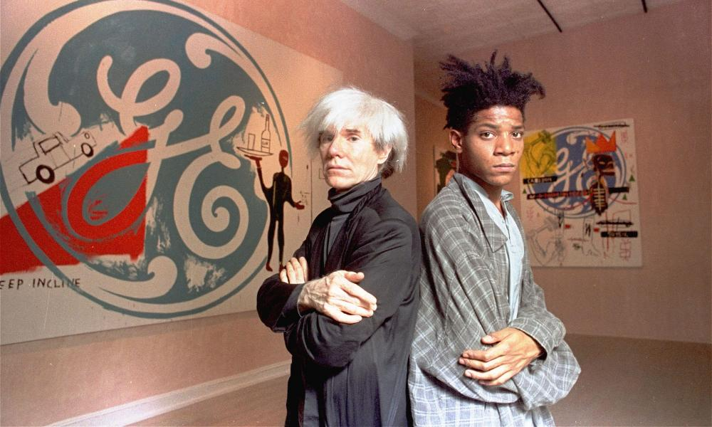Jean-Michel Basquiat and mentor Andy Warhol in 1985.