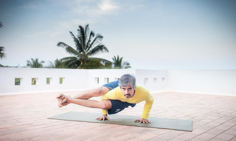 Bharat Shetty, practising yoga in Mysuru, India.