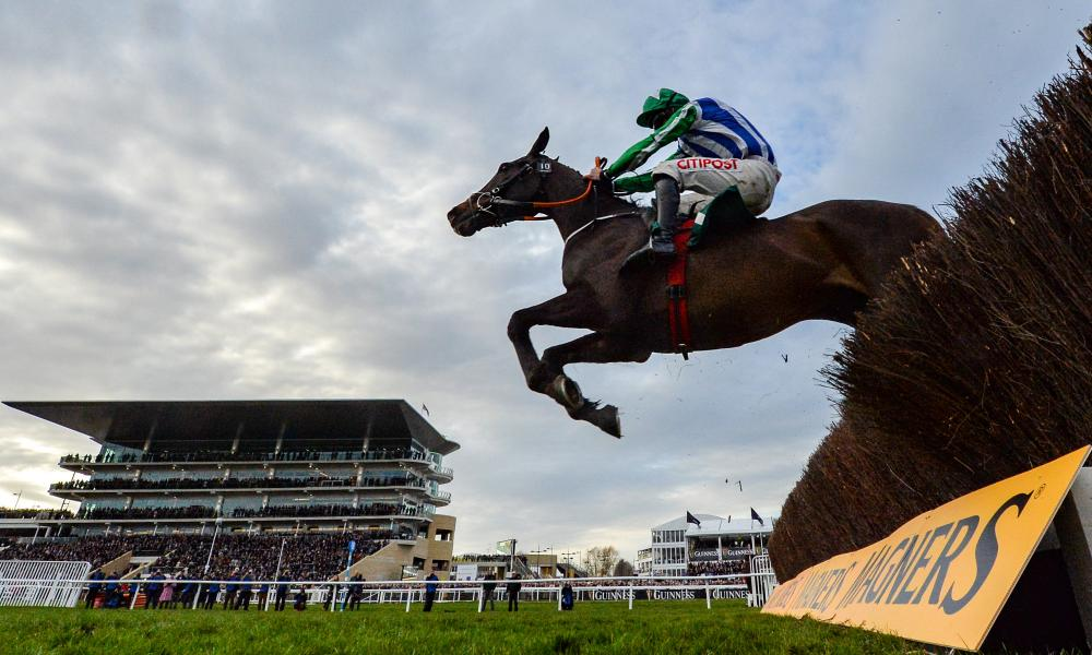 Chosen Mate, with Davy Russell up, jump the last on their way to winning the Johnny Henderson Grand Annual Challenge Cup.