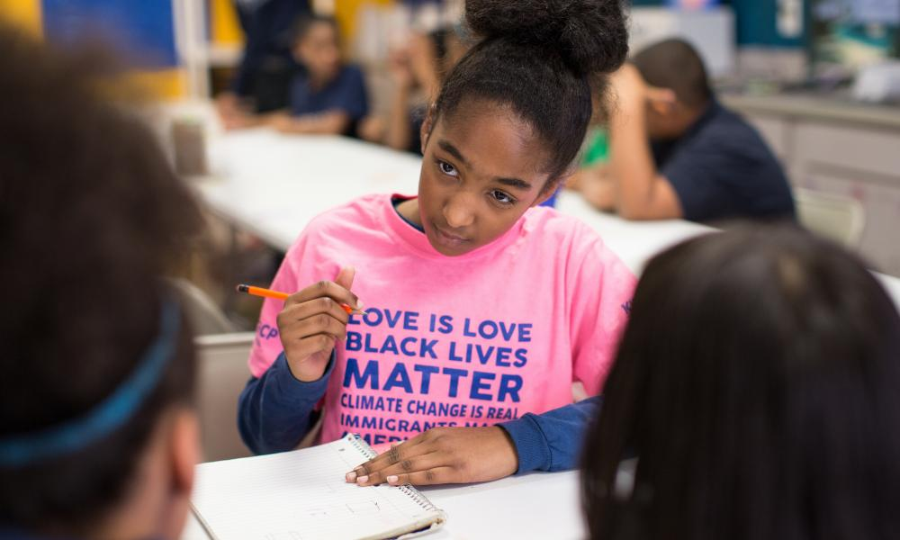 Keyani Gordon works out decisions about an art class project with her classmates at the KIPP Gaston College Preparatory middle school