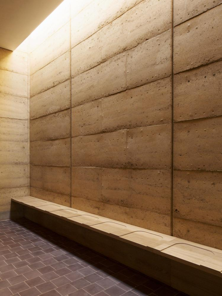 The rammed-earth wall of one of the ceremonial rooms.
