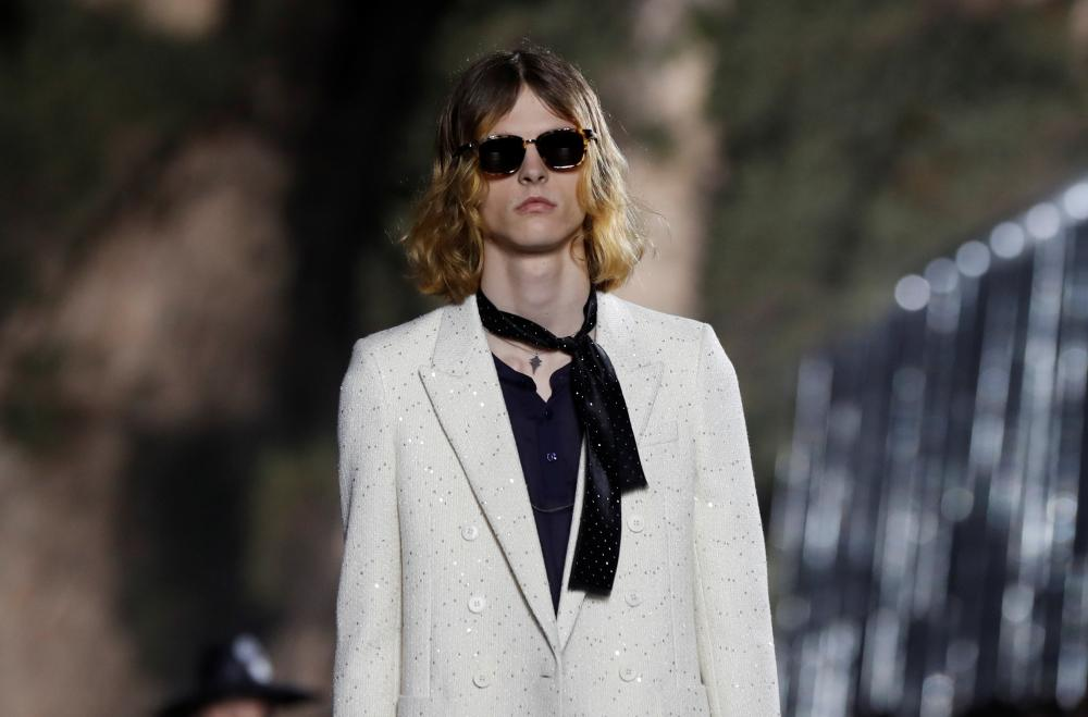A model presents a creation at the Saint Laurent men's collection.