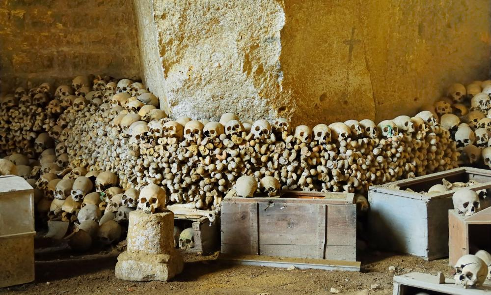Naples, Italy : Cemetery of Fontanelle, the ossuary, with piles of human skulls.