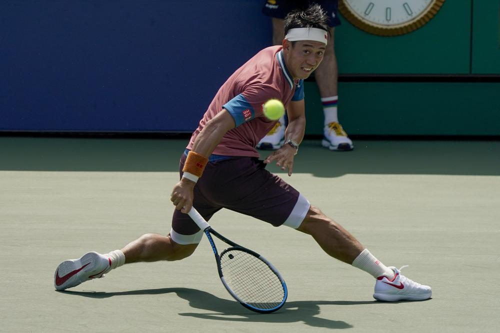 Kei Nishikori returns a shot during his first round victory over Salvatore Caruso.