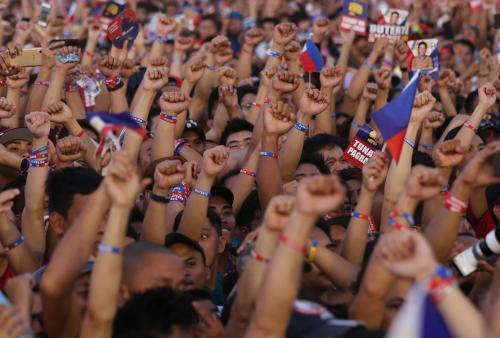 Supporters of Philippine presidential candidate Rodrigo Duterte raise their clenched fists during his final campaign rally before the country goes to the polls.
