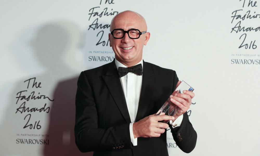 President and CEO of Gucci, Marco Bizzarri, poses with his award after being named winner of the International Business Leader award.