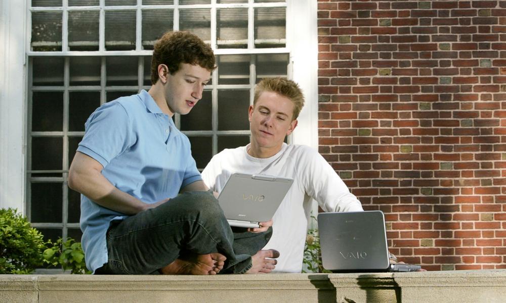 Facebook's Mark Zuckerberg with co-founder Chris Hughes at Harvard University in 2004.
