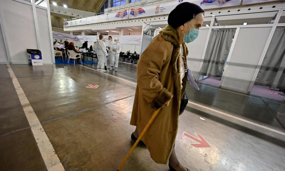 An elderly woman arrives to receive a dose of Chinese-made Sinopharm Covid-19 vaccine in Belgrade Fair turned into a vaccination centre, on February 4, 2021.