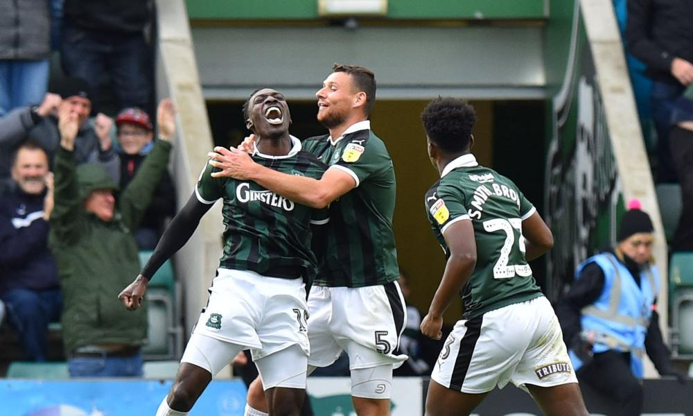 Freddie Ladapo (left) is joined by his teammates after scoring Plymouth's winner.