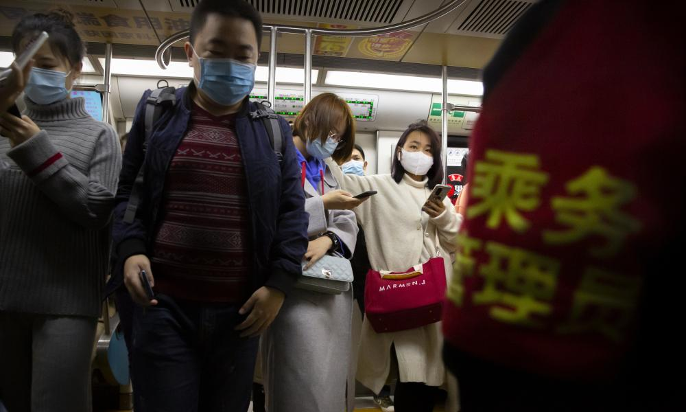 People wearing face masks to protect against the coronavirus ride on a subway train in Beijing, Thursday, 29 October, 2020.