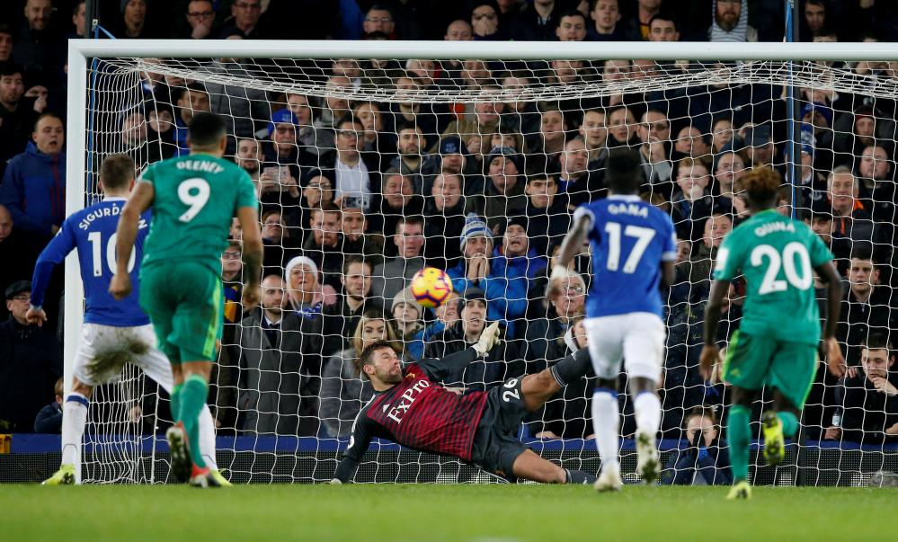 Ben Foster saves Sigurdsson's penalty with his left foot.