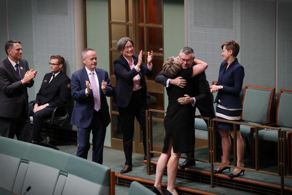 Tanya Plibersek hugs senator Murray Watt.