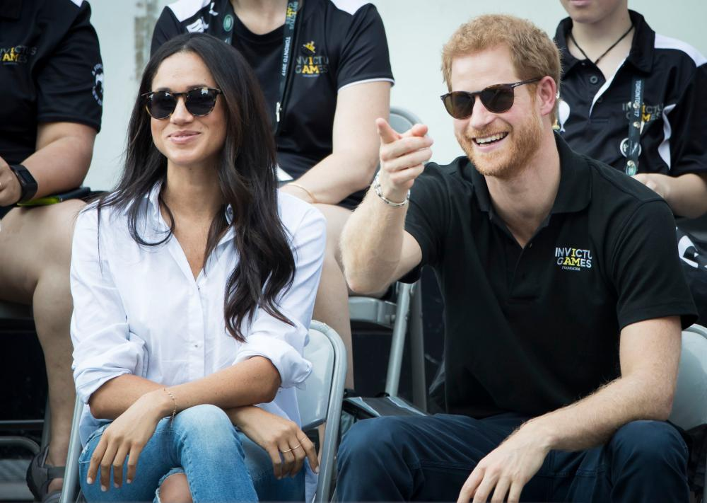 Meghan Markle her then boyfriend at the 2017 Invictus Games in Toronto, Canada.