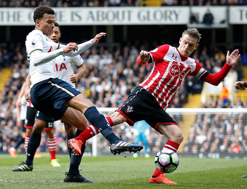 Tottenham's Dele Alli is fouled by Southampton's Steven Davis for a penalty