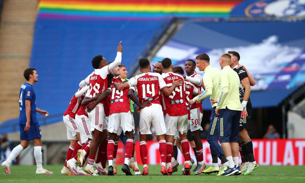 Arsenal players celebrate following their team's victory in the FA Cup Final.