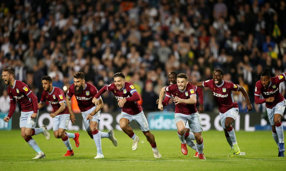 Aston Villa players rush to celebrate with final penalty scorer Tammy Abraham and keeper Jed Steer.