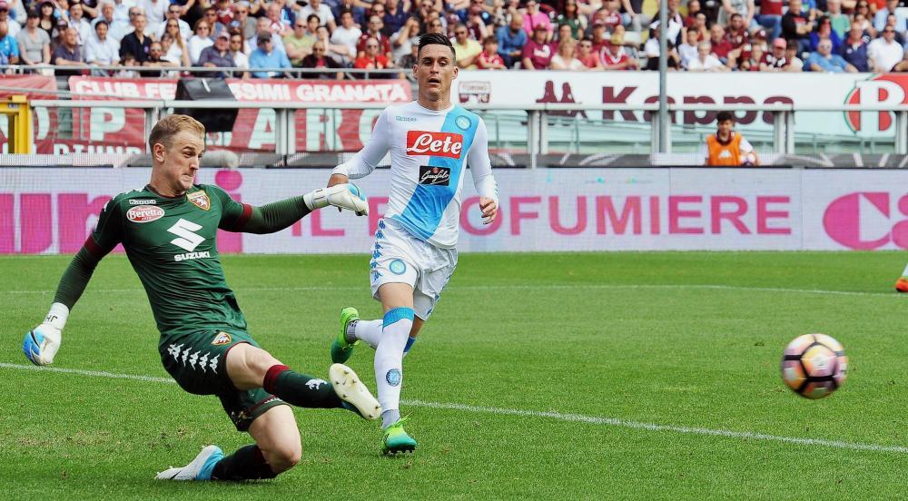Torino goalkeeper Joe Hart kicks the ball past Napoli's Jose Callejon