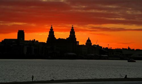 The sun rises behind the Liver Building in Liverpool