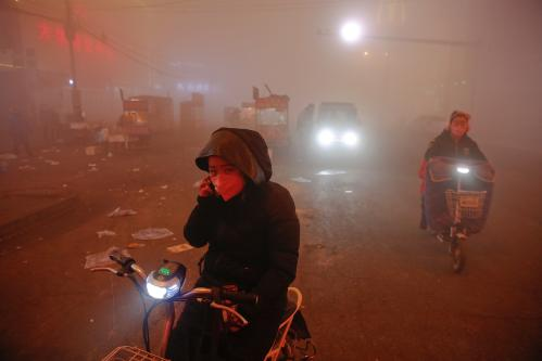 Commuters contend with a smoggy journey in Shengfang, Hebei province, China