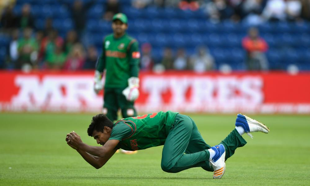 Bangladesh fielder Mustafizur Rahman swoops to catch Ross Taylor.