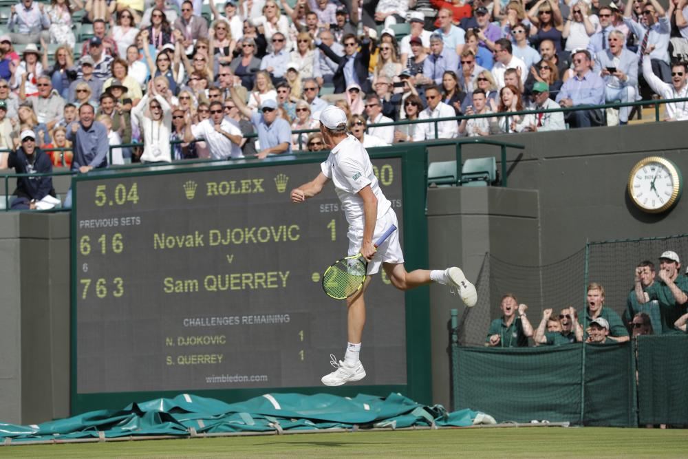 Sam Querrey celebrates his win over Novak Djokovic.
