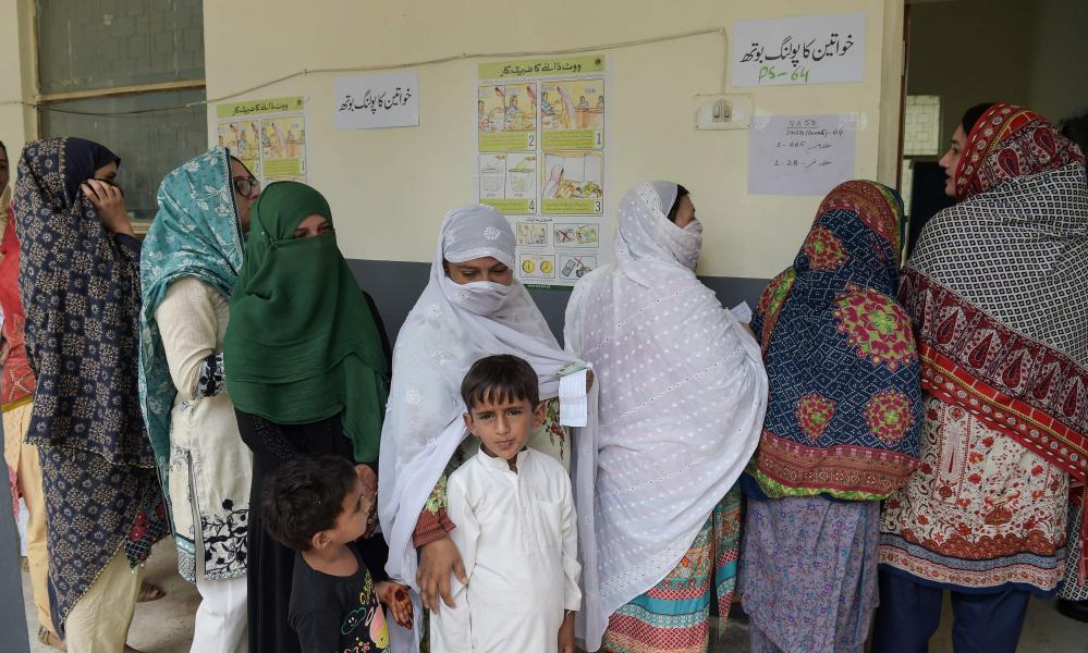 Women stand in a queue at a polling station in Islamabad. Polls opened on July 25 in a tense, unpredictable Pakistani election.