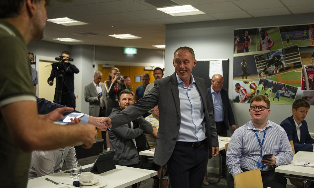 Steve Cooper shakes hands after his first press conference as Swansea City manager.