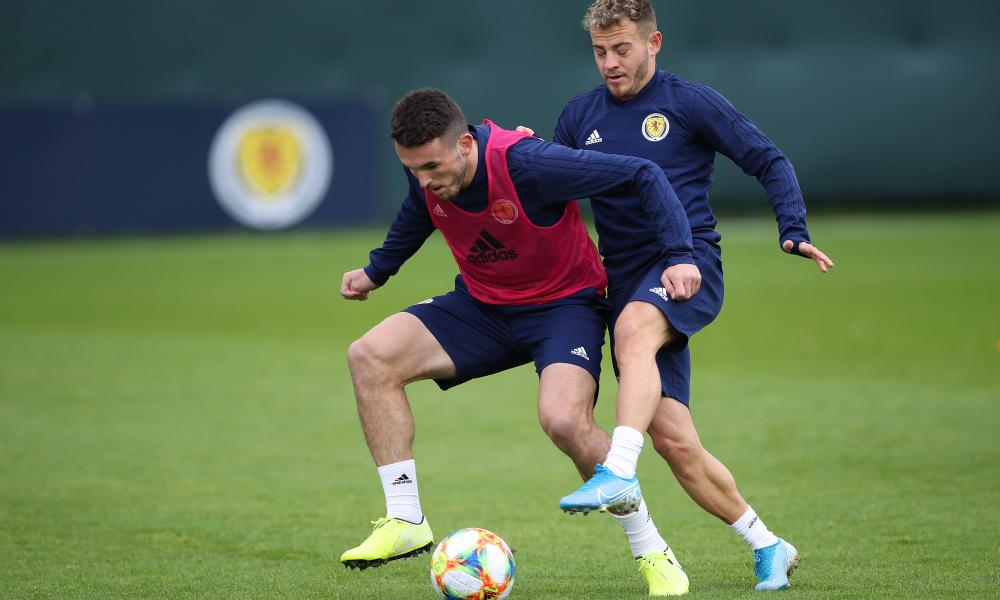 John McGinn holds off Ryan Fraser during Scotland training before the match in Russia.