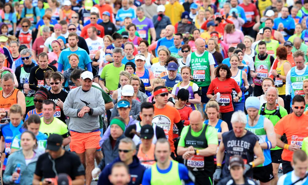 Runners make their way over the start line during the 2016 London marathon.