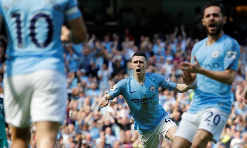 Phil Foden (centre) celebrates his early header, which proved to be the match's decisive moment.