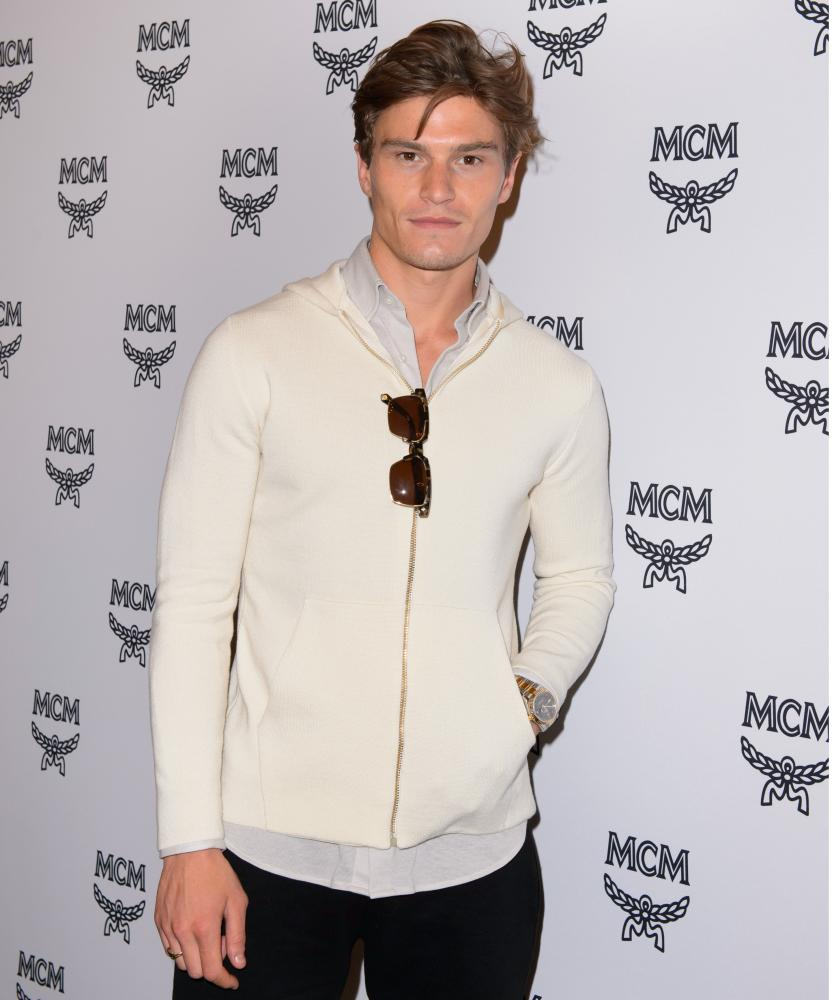 Model Oliver Cheshire in cream Christoper Raeburn knitwear.